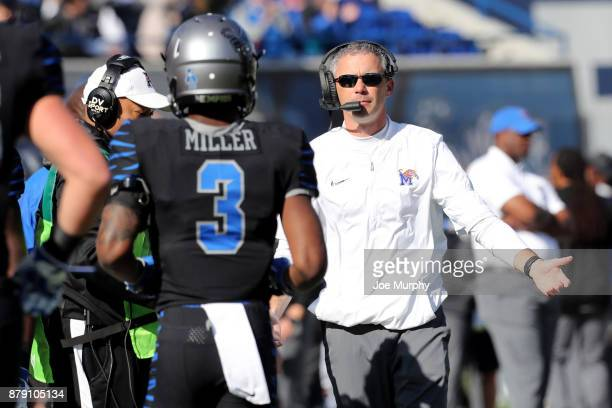 Mike Norvell head coach of the Memphis Tigers talks with Anthony Miller of the Memphis Tigers against the East Carolina Pirates on November 25 2017...