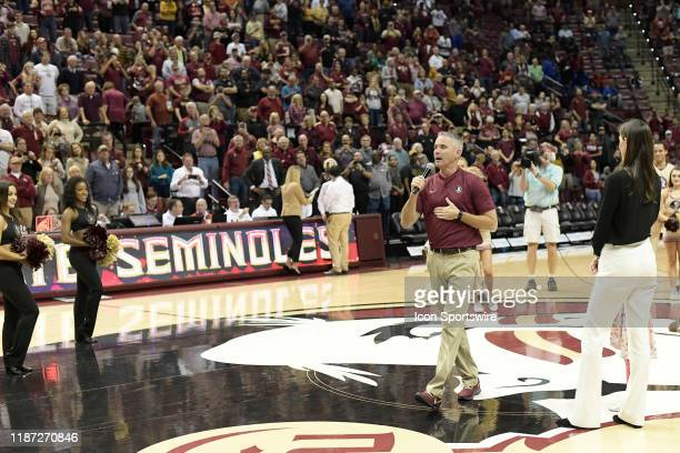Mike Norvell new Florida State University Seminoles head football coach greets fans during an Atlantic Coast Conference basketball game Sunday...