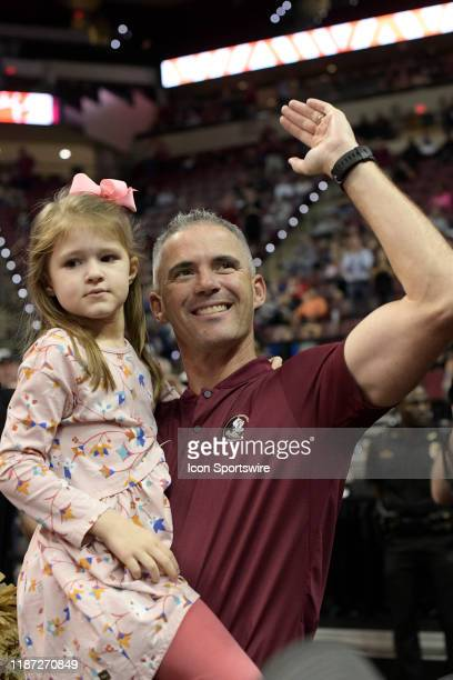 Mike Norvell new Florida State University Seminoles head football coach and five yearold daughter Mila greets fans during an Atlantic Coast...
