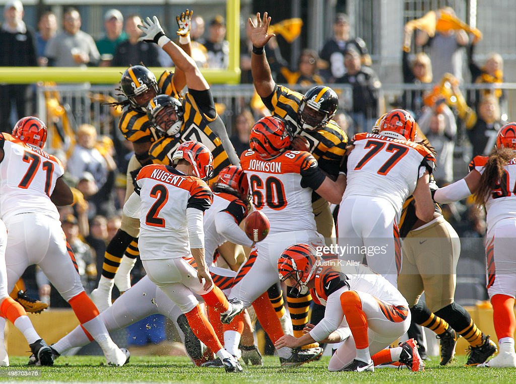 Mike Nugent #2 and Kevin Huber #10 of the Cincinnati Bengals in action during the game against the Pittsburgh Steelers on November 1, 2015 at Heinz Field in Pittsburgh, Pennsylvania.