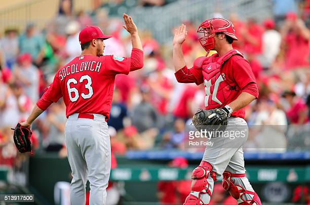 Mike Ohlman of the St Louis Cardinals highfives Miguel Socolovich after the spring training game against the Miami Marlins on March 5 2016 in Jupiter...
