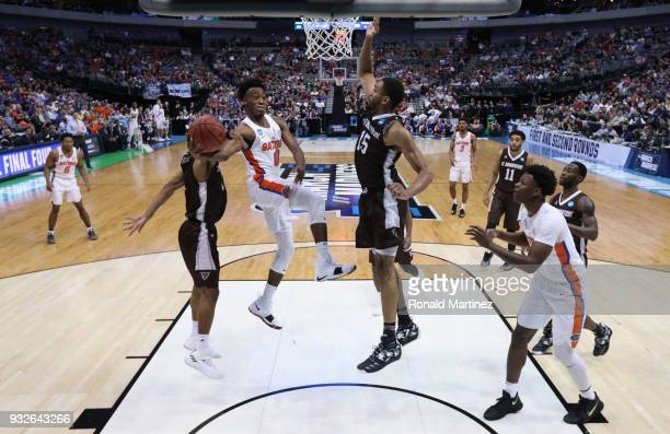 Mike Okauru of the Florida Gators shoots against LaDarien Griffin of the St Bonaventure Bonnies in the first half in the first round of the 2018 NCAA...