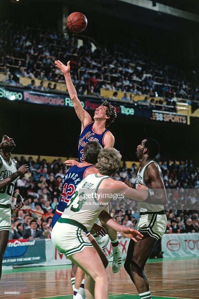 Mike O'Koren #31 of the New Jersey Nets shoots a layup against Larry Bird #33 of the Boston Celtics during a game played in 1983 at the Boston Garden in Boston, Massachusetts.