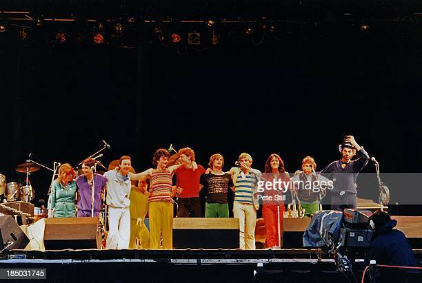 Mike Oldfield and his band take a final bow after performing on stage at the Knebworth Festival, on June 21st, 1980 in Hertfordshire, England....