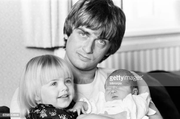 Mike Oldfield musician and composer pictured at home with family eldest daughter Molly and baby son Dougal Buckinghamshire September 1981