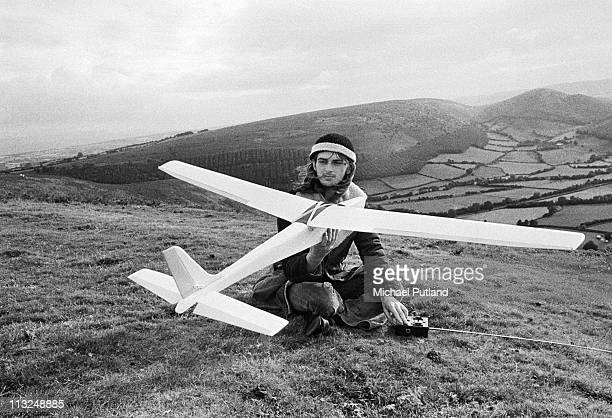 Mike Oldfield portrait with a remote control model plane on Hergest Ridge Herefordshire UK 1974