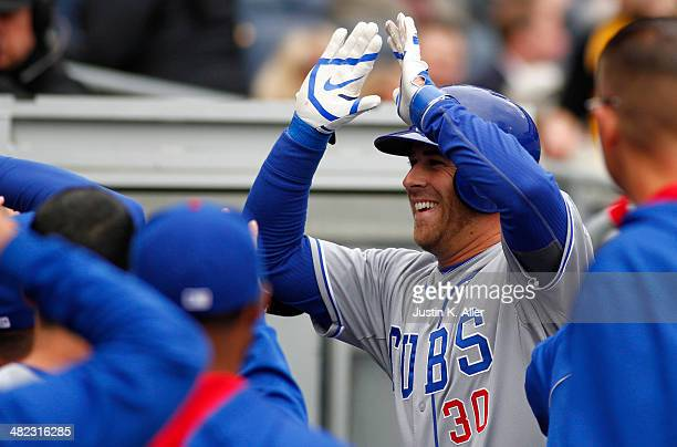 Mike Olt of the Chicago Cubs celebrates after hitting a solo home run in the second inning against the Pittsburgh Pirates during the game at PNC Park...