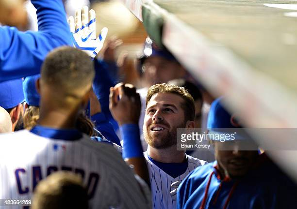 Mike Olt of the Chicago Cubs is greeted in the dugout after hitting a tworun home run scoring teammate Anthony Rizzo during the fifth inning against...
