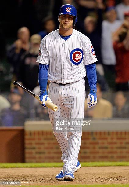 Mike Olt of the Chicago Cubs reacts after striking out during the ninth inning against the Cincinnati Reds at Wrigley Field on June 25 2014 in...