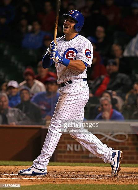 Mike Olt of the Chicago Cubs reacts after striking out in the 9th inning against the St Louis Cardinals during the Opening Night game at Wrigley...