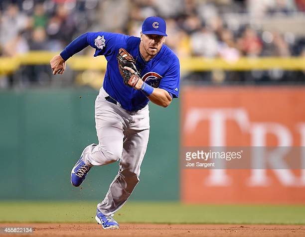 Mike Olt of the Chicago Cubs runs over to first base during the game against the Pittsburgh Pirates on September 13 2014 at PNC Park in Pittsburgh...