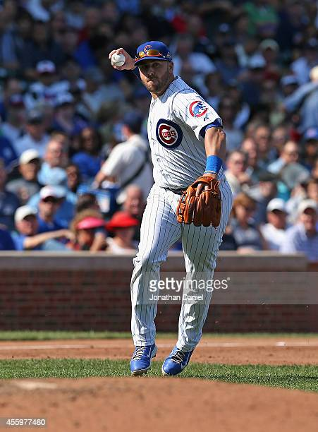 Mike Olt of the Chicago Cubs throws to first base against the Los Angeles Dodgers at Wrigley Field on September 19 2014 in Chicago Illinois The...