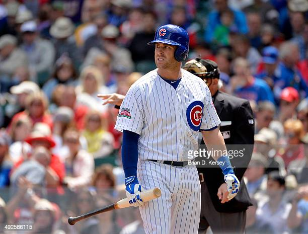 Mike Olt of the Chicago Cubs walks back to the dugout after striking out during the second inning against the St Louis Cardinals at Wrigley Field on...