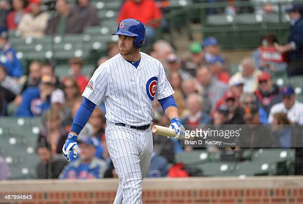 Mike Olt of the Chicago Cubs walks off the field during the first inning against the Arizona Diamondbacks at Wrigley Field on April 24 2014 in...