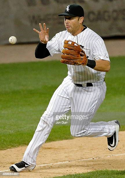 Mike Olt of the Chicago White Sox fields the ball and throws to first base for the out against the Oakland Athletics during the eighth inning at US...