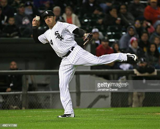 Mike Olt of the Chicago White Sox tries to throw out Salvador Perez of the Kansas City Royals in the 6th inning at US Cellular Field on September 30...