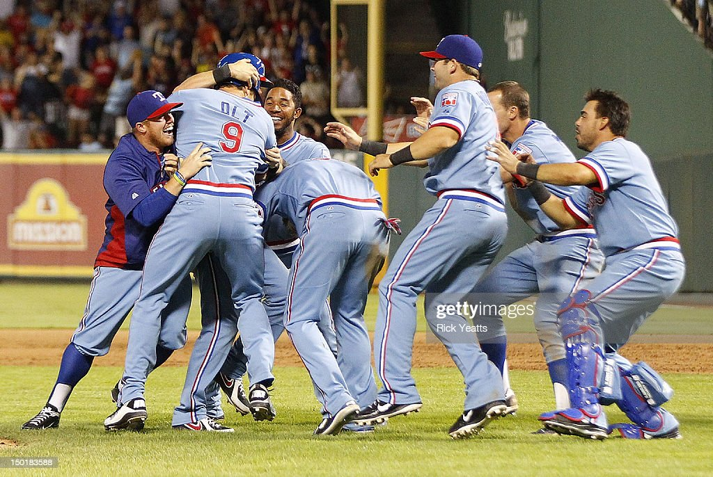 Mike Olt #9 of the Texas Rangers is congratulated by his teammates for hitting a walk off single for the win against the Detroit Tigers at Rangers Ballpark in Arlington on August 11, 2012 in Arlington, Texas.