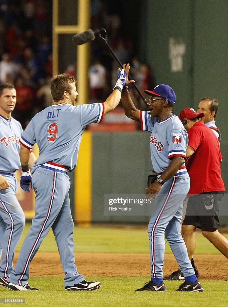 Mike Olt #9 of the Texas Rangers is congratulated by manager Ron Washington #38 for hitting a walk off single for the win against the Detroit Tigers at Rangers Ballpark in Arlington on August 11, 2012 in Arlington, Texas.