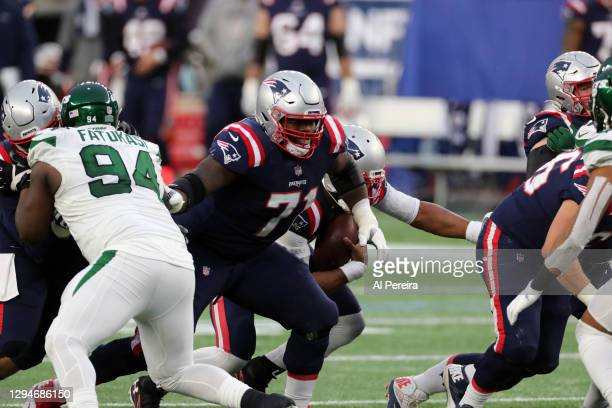 Mike Onwenu of the New England Patriots blocks against the New York Jets at Gillette Stadium on January 3, 2021 in Foxborough, Massachusetts.