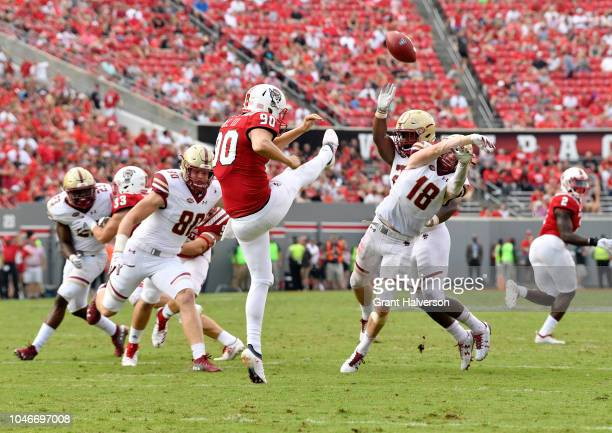 Mike Palmer of the Boston College Eagles blocks a punt by AJ Cole III of the North Carolina State Wolfpack during their game at CarterFinley Stadium...