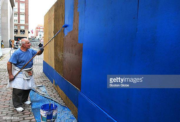Mike Pantelides has been painting the marathonblue color of paint on the boards that line the finish line for the last 36 years He paints the board...