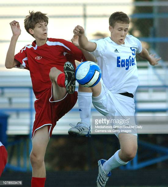 Mike Park right Broomfield High School collides with Jesse Pine Glenwood Springs High School during the first state playoff game at Elizabeth Kennedy...