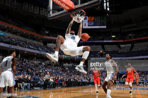 Mike Parks Jr #10 of the Memphis Tigers dunks the ball against the Florida AM Rattlers on December 29 2018 at FedExForum in Memphis Tennessee Memphis...