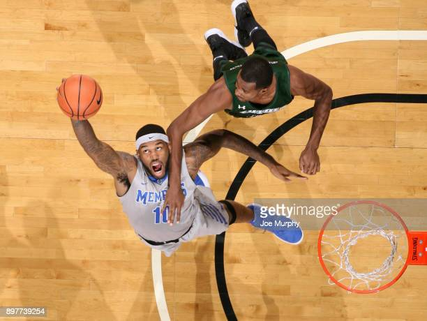 Mike Parks Jr #10 of the Memphis Tigers grabs a rebound against the LoyolaMaryland Greyhounds on December 23 2017 at FedExForum in Memphis Tennessee...