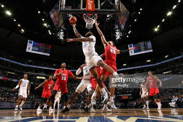 Mike Parks Jr #10 of the Memphis Tigers shoots a reverse layup against the SMU Mustangs on January 19 2019 at FedExForum in Memphis Tennessee Memphis...