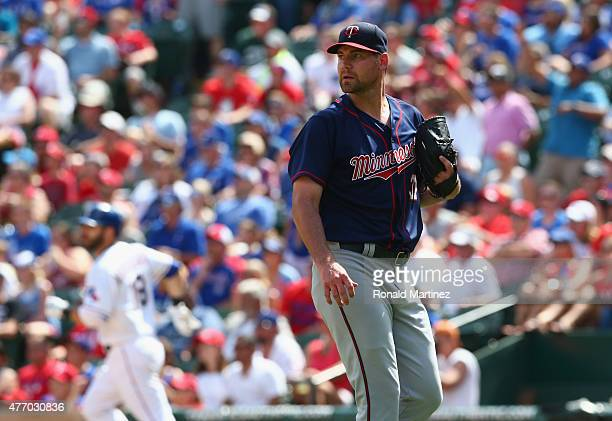 Mike Pelfrey of the Minnesota Twins steps off the mound after giving Mitch Moreland of the Texas Rangers a rbi double in the third inning at Globe...