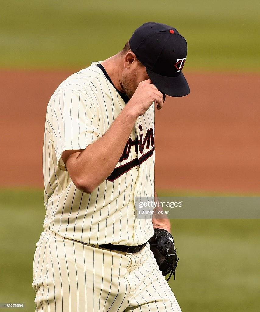 Mike Pelfrey #37 of the Minnesota Twins walks off the field after being pulled from the game against the Houston Astros during the fourth inning on August 29, 2015 at Target Field in Minneapolis, Minnesota. The Astros defeated the Twins 4-1.