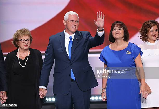 Mike Pence 2016 Republican vice presidential nominee second left waves while on stage with mother Nancy PenceFritsch left wife Karen Pence and...
