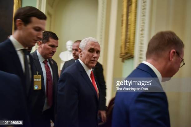 Mike Pence C Jared Kushner L and new White House Chief of Staff Mick Mulvaney R pass through the Senate side of the United States Capitol on Friday...