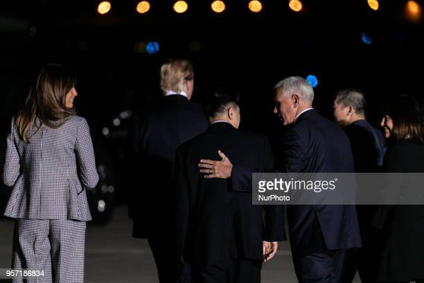 Mike Pence puts his hand on the back of Tony Kim an American citizen released from detention in North Korea as they speak leaving Joint Base Andrews...