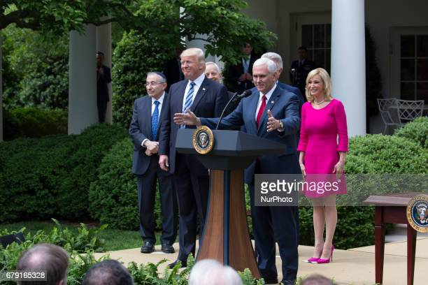 VP Mike Pence spoke with President Donald Trump Rabbi Marvin Hier Cardinal Donald Wuerl Pastor Jack Graham and Pastor Paula White at his side at the...