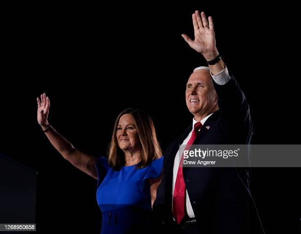 Mike Pence stands with his wife Karen Pence before accepting the vice presidential nomination during the Republican National Convention from Fort...