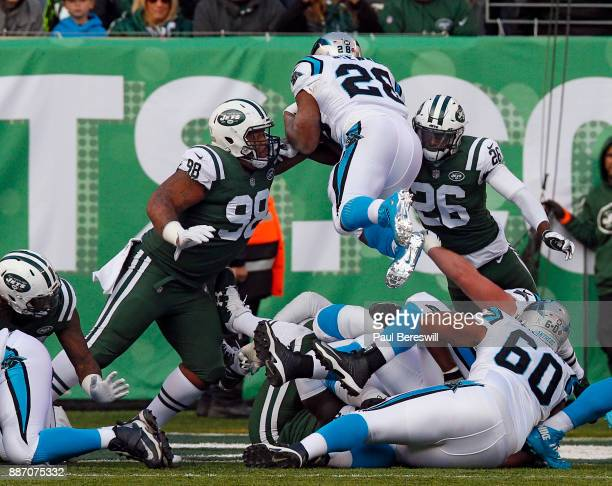 Mike Pennel and Marcus Maye of the New York Jets stop Jonathan Stewart of the Carolina Panthers from diving into the end zone for a touchdown during...