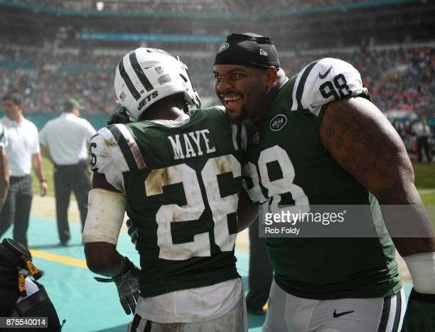 Mike Pennel hugs Marcus Maye of the New York Jets during the game against the Miami Dolphins at Hard Rock Stadium on October 22 2017 in Miami Gardens...