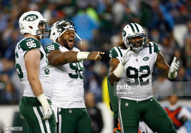 Mike Pennel of the New York Jets and Leonard Williams celebrate a play against the Tennessee Titans in the fourth quarter at Nissan Stadium on...