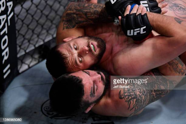 Mike Perry and Tim Means grapple in their welterweight bout during the UFC 255 event at UFC APEX on November 21, 2020 in Las Vegas, Nevada.