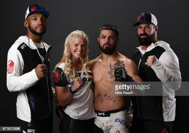 Mike Perry poses for a portrait backstage with his team after his victory over Jake Ellenberger during the UFC Fight Night event at Bridgestone Arena...