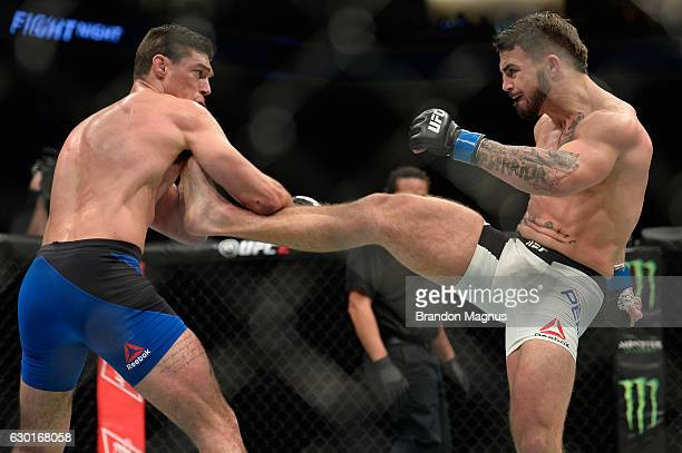 Mike Perry punches Alan Jouban in their welterweight bout during the UFC Fight Night event inside the Golden 1 Center Arena on December 17 2016 in...