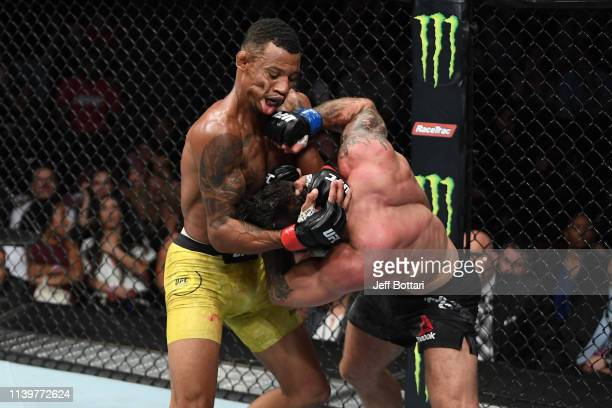 Mike Perry punches Alex Oliveira of Brazil in their welterweight bout during the UFC Fight Night event at BB&T Center on April 27, 2019 in Sunrise,...