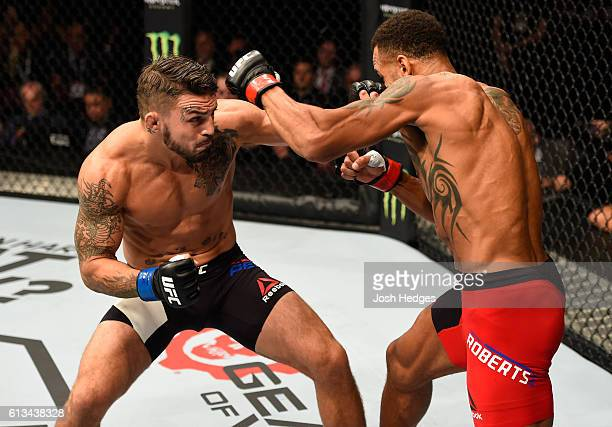 Mike Perry punches Danny Roberts of England in their welterweight bout during the UFC 204 Fight Night at the Manchester Evening News Arena on October...