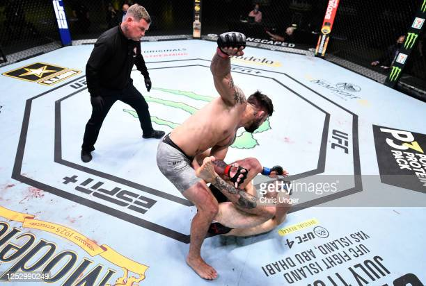 Mike Perry punches Mickey Gall in their welterweight fight during the UFC Fight Night event at UFC APEX on June 27 2020 in Las Vegas Nevada