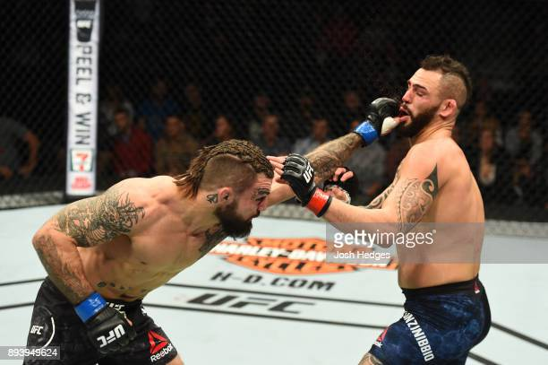 Mike Perry punches Santiago Ponzinibbio of Argentina in their welterweight bout during the UFC Fight Night event at Bell MTS Place on December 16...