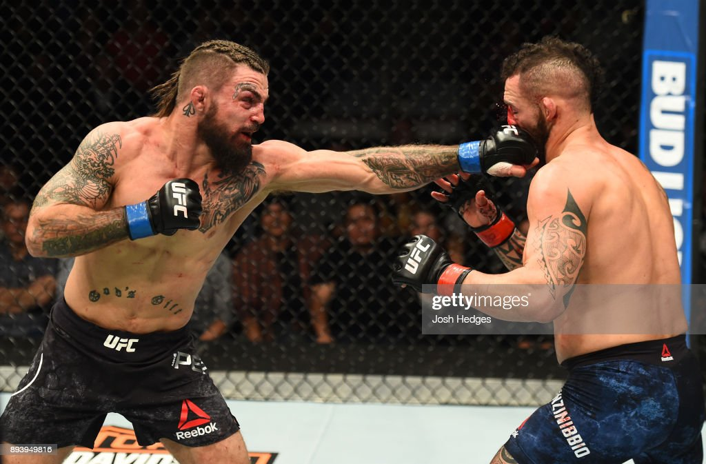 Mike Perry punches Santiago Ponzinibbio of Argentina in their welterweight bout during the UFC Fight Night event at Bell MTS Place on December 16, 2017 in Winnipeg, Manitoba, Canada.