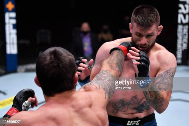 Mike Perry punches Tim Means in their welterweight bout during the UFC 255 event at UFC APEX on November 21, 2020 in Las Vegas, Nevada.