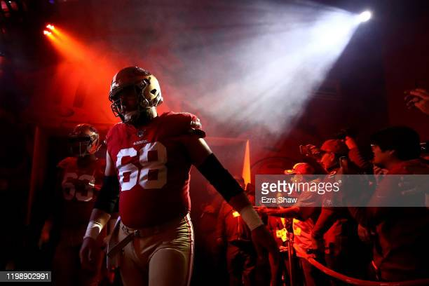 Mike Person of the San Francisco 49ers walks through the tunnel prior to the NFC Divisional Round Playoff game against the Minnesota Vikings at...