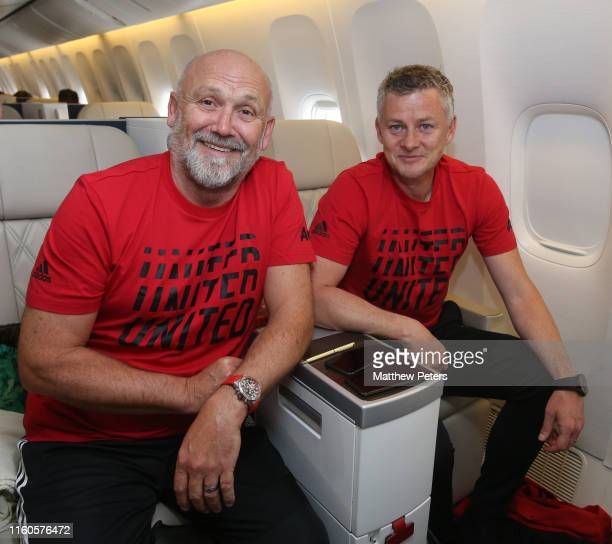 Mike Phelan and Manager Ole Gunnar Solskjaer of Manchester United pose on the plane ahead of their pre-season tour of Australia, Singapore and China...